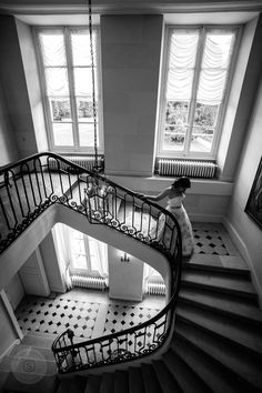 Down the Escalier d'honneur, the Grand Staircase, the bride on her way to waiting groom and guests.