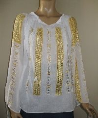 Yellow silk hand made lace on a superb Romanian folk blouse .  Available at www.greatblouses.com