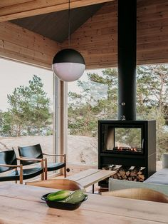 Finnish designers Aleksi Hautamaki and Milla Selkimaki purchased a island two years ago, on the edge of the Archipelago National Park in Finland, and have since built this self-sufficient summer house that includes a sauna, a guesthouse and a Ideas Cabaña, Scandinavian Cabin, Two Sided Fireplace, Mounted Fireplace, Summer Deco, Light Hardwood Floors, Wooden Cabins, Wooden Decks, Design Furniture