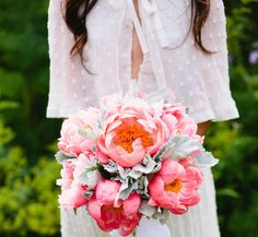 flowy lace wedding dress sleeves floral bouquet pink