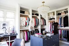 Alice Lane Home - Stunning walk-in closet features a clear beaded tiered…