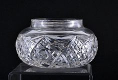 Powder Jar Box Antique Cut Glass American Brilliant Vanity Crystal Glass     Once a staple on every ladies' vanity table is this handsome antique cut glass crystal glass powder jar (no lid).     This is a heavy leaded hand cut glass powder jar with crystal clear glass.    The heavy glass powder jar has two motifs repeating around the outside of the jar.  One motif is a hobstar and the second a diamond motif.     The powder jar is 2 1/2 inches high by 4 1/2 inches wide.  The outside dimension…