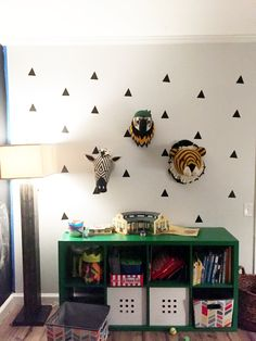 Fiona walker England animal heads. Tiger, Zebra from Anthropologie Parrot from Rosenberry Rooms.