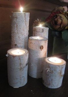 unconventional candle holder - birch pieces!  Put some birch leaves (or natural seasonal decor - like snow in the winter?) around the base for a splash of color OR a mirror to make those birch 'trees' look longer!  or a mirror behind to reflect and grow your mini forest.