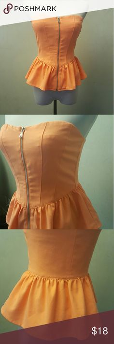 Orange zip up tube top Orange zip up tube top soft fabric, has a little spot on the chest shown in pict 6. Forever 21 Tops Tunics