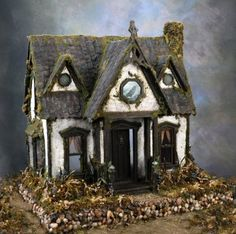 great way to decorate the typical unfinished dollhouse to create your own witch's / haunted house.