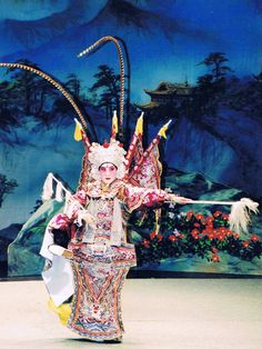 Chinese opera - Performer is in full military gear, signifying that this actor is playing a general in the play, perhaps in the midst of battle scene.