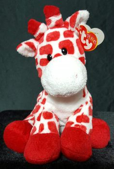 This is a pre-owned retired 2007 Ty Pluffies Kisser the Giraffe. as I am happy…
