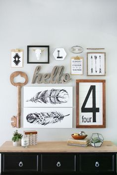Rustic country decors blends with your love of chic design in this beautiful gallery wall. Thanks to the monochromatic aesthetic, it couldn't be easier to recreate this charming decoration in your living room or entryway.