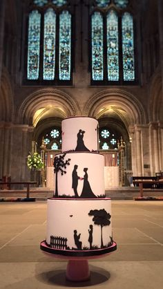 Story Silhouette Wedding Cake, photographed beneath the Stained Glass Window of Romsey Abbey