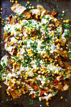 Healthy Grilled Sweet Potato Nachos - roasted corn, black beans, grilled sweet potatoes, multigrain chips, and a lightened up homemade cheese...