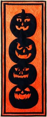 """This funny bunch of Jack O' Lanterns, based on real-life carved pumpkins brings Halloween spirit to every home. It was designed as a wall hanging but can be used as a table runner too. Finished Size:  Wall Hanging or Table Runner 12"""" x 32"""". Skill Level: Intermediate. Technique:  Pieced/Applique. Halloween Quilts, Halloween Patterns, Spirit Halloween, Fall Halloween, Last Minute Kostüm, Popsicle Stick Art, Sew Kind Of Wonderful, The Barnyard, Spooky Treats"""
