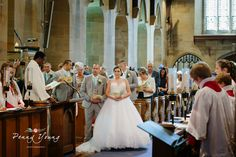 Bride and groom during ceremony.  Brides processional. Summer wedding at High Rocks in Tunbridge Wells Kent.  Church wedding. St Pauls Church in Rusthall Tunbridge Wells Kent. Photography by Penny Young Photography.