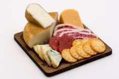 assorted cheese and meat with crackers board by amanspeak on Etsy