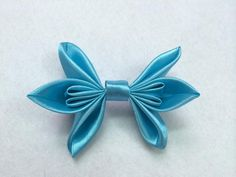 Make pretty ribbon bows with satin fabric for a shiny shimmering look. Use bows to make pretty hair accessories.     Materials   	satin ribbon 	scissors 	thread and needle