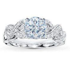 3/8 ctw 14k mounting to be set with .50-1.50 round or princess diamond, $1299.