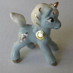 http://data.whicdn.com/images/5419075/vintage-hagen-renaker-disney-blue-unicorn-fantasia_130433295188_large.jpg