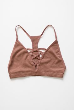 A simple bralette with the criss cross strappy detailing in front and a racerback. Wear it underneath loose-fitting shirts, or even as a yoga top. Made with lightweight knit material that has a good s