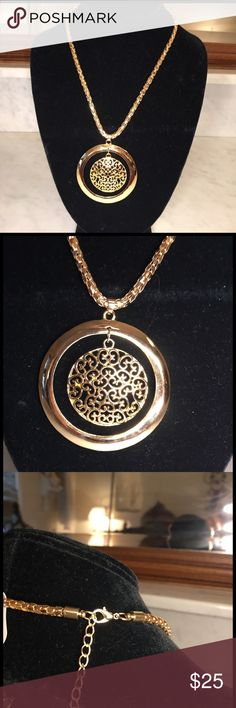 New Golden Pendent with heavy chain This is a beautiful gold pendent with a nice heavy gold chain. Now that yellow gold is back in a big way, this piece is sure to please with any outfit that calls for a statement piece to adorn your neck. The chain is made up of small Dimond links that gives it a regal appearance. There is a lobster claps to hold it securely in place. Farah Jewelry Jewelry Necklaces