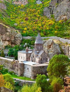 Geghard Monastery, Unesco World Heritage Site in central Armenia.  It is partially carved out of the adjacent mountain, surrounded by cliffs. There are some structures that survive from 1215, but many were reconstructed from the ground up in the 17th and 20th centuries. (via photo-armenia.com).