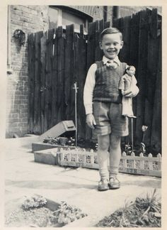 Boy In the Garden with unusual doll