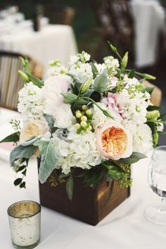 Rustic wooden box centerpiece with lush arrangement of peach, ivory, and blush floral//Floral by Swoon Floral Design in Portland, Oregon