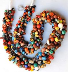 Large Mauritanian necklace made with many hundreds of old European glass, stones, shells and African-made glass beads   Every loop of beads is tied with metal to the main core. Contemporary