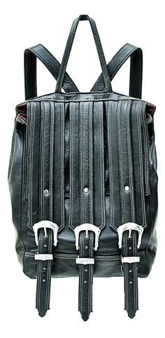 The original Triple Strap Backpack in distressed cowhide leather with engraved western buckles.