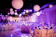 "The reception took place at Heaven Event Center and incorporated a contemporary look with purple orchid centerpieces and lanterns strung from the ceiling. ""It was ultra modern with white walls and LED lights,"" Jesse says. ""It had a chic loft look.""Photo: Lori Barbely Photography"