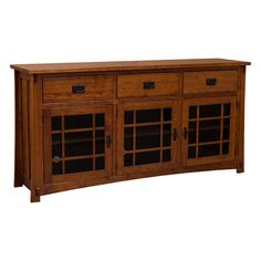 "This 72"" Amish Mission TV Stand is constructed skillfully in the United States by highly experienced Amish Craftsmen using Cherry wood. This TV Stand offers plenty of storage space. In addition, it features mullion glass doors over three compartments with adjustable shelves. The drawers have a full extension glides pair with English dovetail joints that provide durability and sturdy construction.   Available to be custom made in a selection of woods and finishes. This stylish and timeless…"