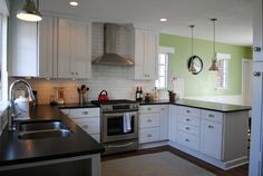 The color in the dining room saves this kitchen from being too white. Also, love, love, love the cabinetry!