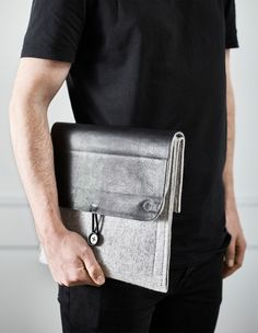 A felt hanging organizer turned into a diy work tech clutch with space for a tablet and a notebook.