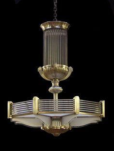 An Art Deco design chandelier manufactured with glass rods in a silver octagonal frame. Design similar to those of Petitot. Arte Art Deco, Estilo Art Deco, Art Deco Chandelier, Art Deco Lighting, Art Nouveau, Interiores Art Deco, Crystal Lights, Pendant Lights, Muebles Art Deco
