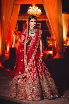 Photo of Red bridal lehenga with green jewellery