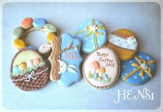 Cute peek-a-boo bunny cookies with a basket of eggs, a little jelly bean wreath, and pretty eggs, expertly piped by HENS1, posted on Cookie Connection