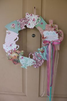Teapot Wreath: foam wreath covered in floral pattern fabric, add teapot cutouts and ribbon