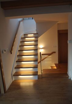 Recessed stair lighting is a great alternative to bulky floor lamps. Interior Lighting, Home Lighting, Stairway Lighting, Hardwood Stairs, Stairs Architecture, Hallway Designs, Modern Stairs, Entrance Ways, Dining Table Design
