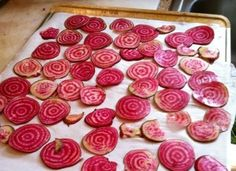 """Beet Chips    The pretty fuchsia pink of fresh beets turns a rich purple when they are baked into crispy chips. Cut two large beats into slices that are 1/8"""" thick, then place on a greased baking sheet. Brush the beets with a light coating of olive oil, and then bake at 325 degrees for about 45 minutes."""