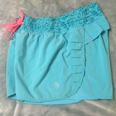 Workout shorts Aqua blue workout shorts! Bought from tjmaxx! Great condition. Barely worn. Has under lining in them MPG Shorts