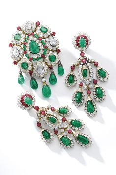 Very important and unique gem set and diamond demi-parure, Van Cleef & Arpels, 1960s Comprising: a necklace of Indian inspiration, set with variously shaped emeralds and rubies, seed pearls, drop-shaped and a carved emerald, circular-cut, cushion-shaped and a pear-shaped diamond, supporting a detachable pendant set with a cabochon pear-shaped emerald, circular-cut rubies, similarly cut, cushion- and drop-shaped emeralds, circular-cut and cushion-shaped diamonds, may be worn as a brooch…