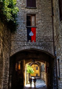 An alley in the medieval walled town of Gubbio province of Perugia , Umbria
