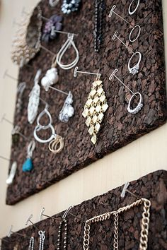 cork tiles and t-pins for organizing jewelry...I am currently using my little corkboard above my dresser to hang my necklace (on thin nails I drove through it) but this looks much classier ha).