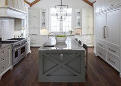 "Beautiful kitchen--love the island color and ""X"" design on island!!  Also light fixture!!"