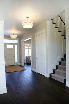 Entry Overview- From Parade of homes. Exactly how I want with floors and stairs