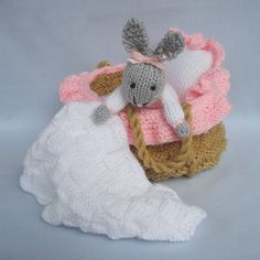 * * Written in ENGLISH * * BABY BUNNY measures 17 cm (6.5 in). Bunnys little crib with handles is ideally suited for small hands to carry. She can be snuggled down to sleep on her frilly pillow and kept warm with her cosy blanket. And when shes not sleeping shell be happy to play alongside