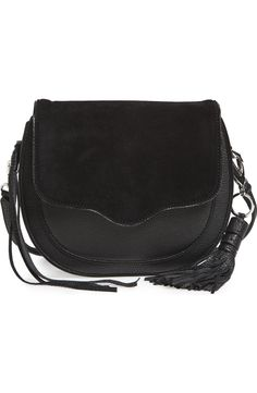 Must have this Rebecca Minkoff crossbody bag to the collection. The black leather and suede combo accompanied by the flirty fringe tassel make this the perfect purse for a night out.