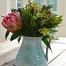 lovely flowers in rustic handmade vase