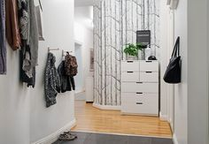 Lower coat hooks make it easier for children to hang their clothes themselves