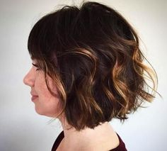 wavy brunette bob with caramel highlights