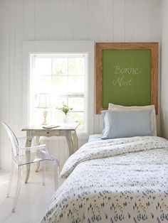Use a chalkboard instead of a headboard - it saves space and doubles as a memo board.